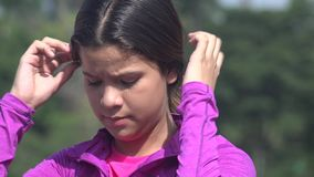 Female Teen Fixing Her Hair stock footage