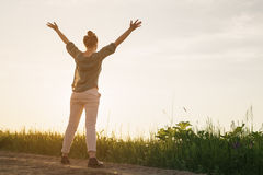 Female teen girl stand feel freedom with arms stretched to the sky copy space for your info Royalty Free Stock Photos