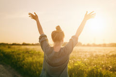 Female teen girl stand feel freedom with arms stretched to the sky Stock Images