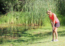 Female teen golfer in rough Royalty Free Stock Photography