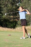 Female teen golfer after swing Royalty Free Stock Photo