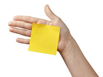 Female teen hand holding sticky note Royalty Free Stock Photography