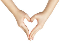 Female teen hand makes heart shape with hands. White background Royalty Free Stock Images