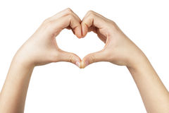 Female teen hand makes heart shape with hands. White background Royalty Free Stock Photos