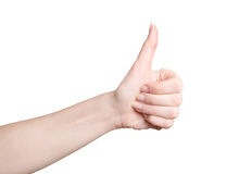 Female teen hand shows thumbs up. Isolated on white Royalty Free Stock Image