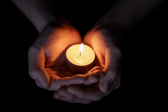 Female teen hands holding burning candle Royalty Free Stock Photo