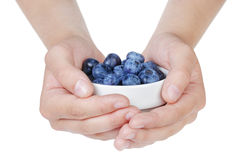 Female teen hands holding ripe blueberries in bowl Royalty Free Stock Photos
