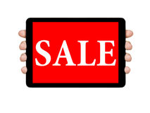 Female teen hands showing tablet pc with sale offer Stock Photo