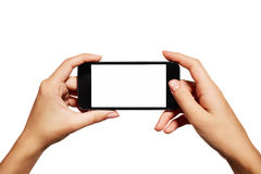 Female teen hands using mobile phone with white Stock Images
