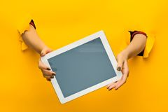 Female teen hands using tablet pc with black screen, isolated Stock Photos