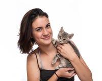 Female teen and her cute kitten. stock photo