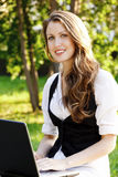 Female teen with laptop Royalty Free Stock Image