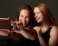 Female Teenage firends in studio taking a selfie Royalty Free Stock Photography