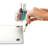 Female Teenage Hand Unscrew Laptop III Stock Photos