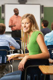 Female Teenage Pupil In Classroom Royalty Free Stock Photo