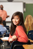 Female Teenage Pupil In Classroom Stock Photography