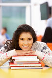 Female Teenage Student In Classroom With Books Royalty Free Stock Photography