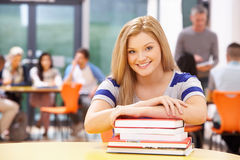 Female Teenage Student In Classroom With Books Royalty Free Stock Image