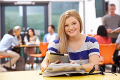 Female Teenage Student In Classroom With Digital Tablet Stock Photo
