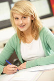Female Teenage Student Studying In Classroom Royalty Free Stock Photography