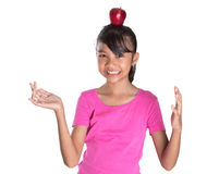 Female Teenager With Apple On Her Head I Royalty Free Stock Image