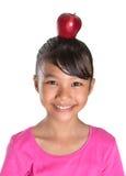 Female Teenager With Apple On Her Head III Stock Photo