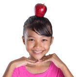 Female Teenager With Apple On Her Head IV Royalty Free Stock Photos