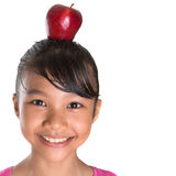 Female Teenager With Apple On Her Head V Stock Photography
