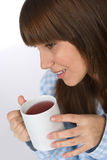 Female teenager with cup of tea for breakfast Stock Photo