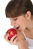 Female teenager eat apple for breakfast Royalty Free Stock Image