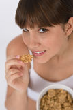 Female teenager eat healthy cereal for breakfast Royalty Free Stock Image