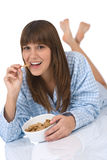 Female teenager eat healthy cereal for breakfast Stock Photography