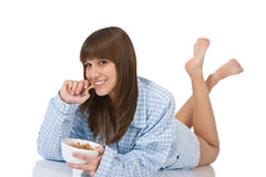 Female teenager eat healthy  cereal for breakfast Stock Images