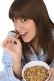 Female teenager eat healthy cereal for breakfast Royalty Free Stock Photo