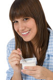 Female teenager eat healthy yogurt for breakfast Royalty Free Stock Images