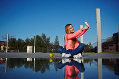 Female teenager having fun in the park Stock Photography