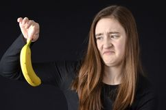Teenager disgusted with bananna Stock Images