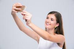 Female teenager making selfie photo on smartphone Royalty Free Stock Photography