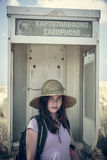 Female teenager in an old call box Stock Image