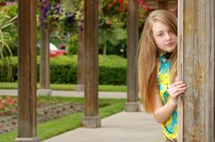 Female teenager in an outdoor garden Royalty Free Stock Image