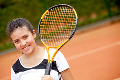 Female teenager playing tennis Stock Images