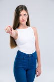 Female teenager pointing finger at camera Royalty Free Stock Image