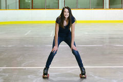Female teenager in roller skating arena Stock Images