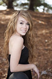 Female teenager smiling with long hair Stock Photo