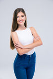 Female teenager standing with arms folded Stock Photos