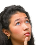 Female teenager is thinking Royalty Free Stock Images