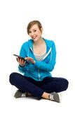 Female teenager using digital tablet Royalty Free Stock Images