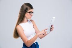 Female teenager using tablet computer Stock Images