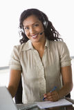 Female telesales worker. In office Royalty Free Stock Photography