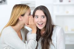 Female telling secret to friend. Female telling secret to her friend Royalty Free Stock Image